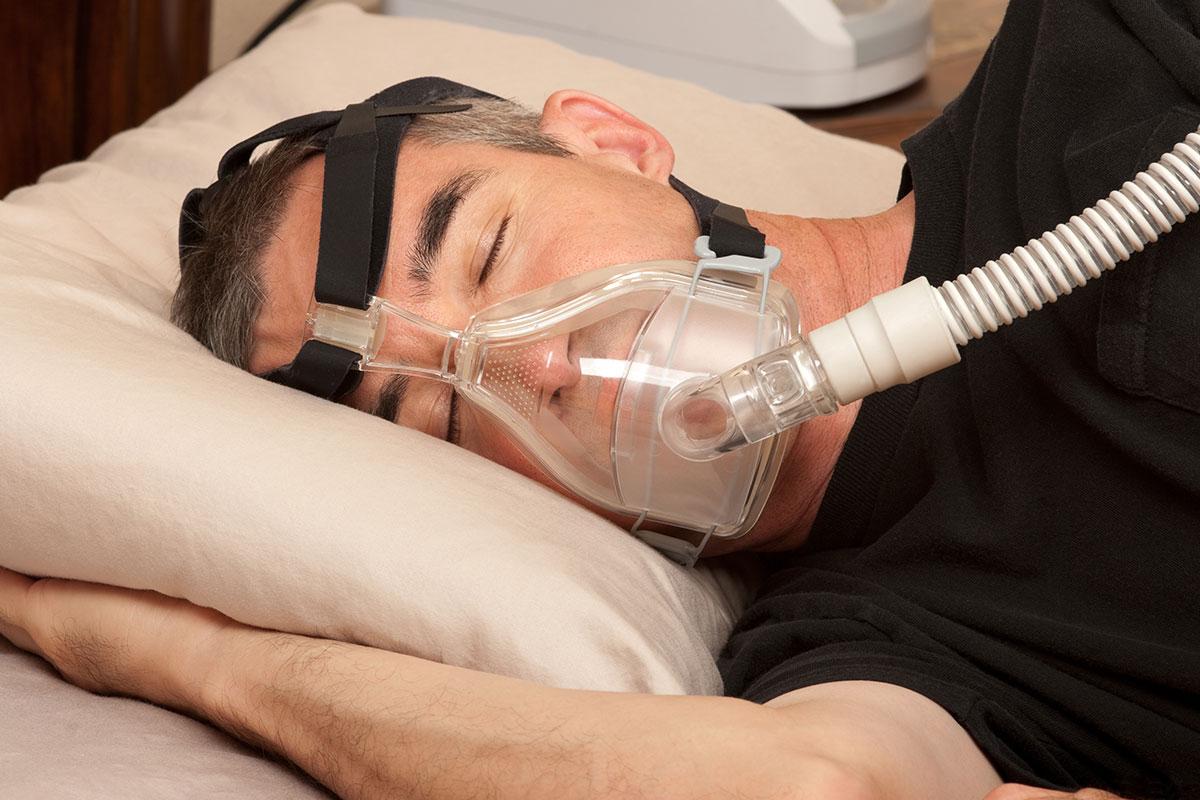 Sleep Apnoea Treatment - Man Wearing a CPAP Mask